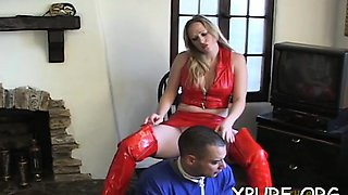 Robust gal shows a boy what female domination means