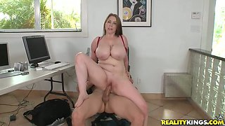 Sex-crazy secretary with giant boobs Desiree rides hard dick of her boss