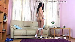 dalila masturbates on couch with a glass dildo