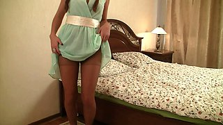 Young brunette lady with cute braids demonstrates her ass in pantyhose