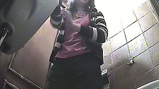 Lovely amateur young chick in the toilet pisses on hidden cam video