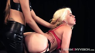 Crazy mistress in latex outfit fucks sex slave with the help of strapon