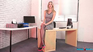 Slender secretary Leah gets naked and poses on the table