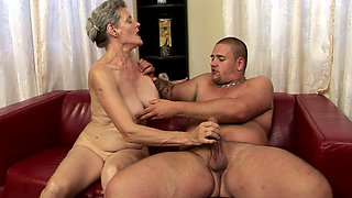 Disgusting granny and brutal boy have awesome oral sex on sofa