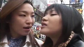 Japanese lesbians kissing on the street then in a hotel room