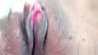 Filipina Rubs Her Smooth Pussy