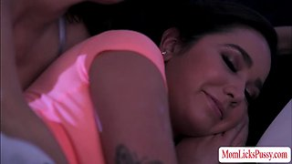 A mommy and smoking hot teen making out in a bed licking each other in the most passionate way