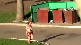 Drunk older woman walks topless