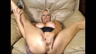 Wonderful super flexible blond haired MILF with big tits masturbates her wet pussy