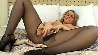 Busty blond housewife torn her black tights to masturbate