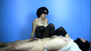 Seductive brunette gives a handjob and gets her feet licked