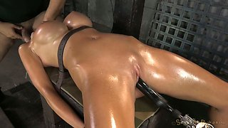 Belted oiled up whore Courtney Taylor gets her muff fucked with sex machine