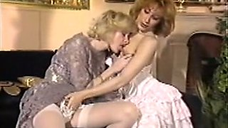 Two naughty elegant white milfs on the couch tease each other