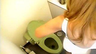 Asian Girl Peeing In Toilet
