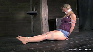 Woman with an amazing body enjoys being tied up by her master