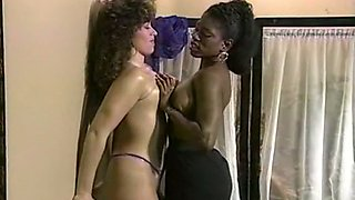 Brunette white lady with big tits likes busty black girl