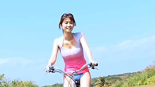 Seductive Asian bitch Ai Date rides a bike with great joy