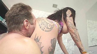 Tattooed babe goes totally naked and gives the guy a cock rodeo