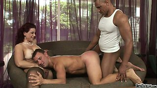 Lustful mature Meridian fucks two bisexual dudes on the couch
