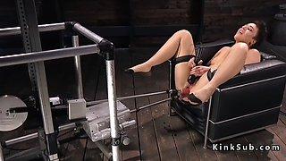 Brunette gets double penetration machine