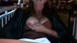 BUsty wife get a bit too horny and plays with her pussy in public restaurent