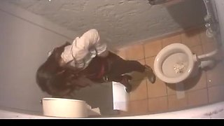 Long hair chick spied in public toilet peeing