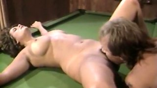 Hot and busty vintage girl blows dick on the pool table