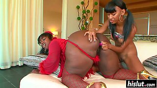 Two black babes have fun with toys