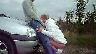 Kinky couple having sex outdoors near the car
