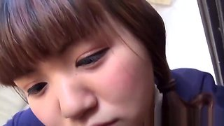 Japanese schoolgirl licking and sucking in closeup