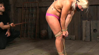 Tied up sexy chick in jeans is suspended and punished