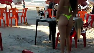 Hot Brazilian babe with big butt walks around the beach in a sensual manner