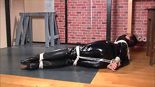 Brunette girl in catsuit tied up
