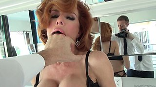 A tall, sexy redhead in lingerie gets fucked in the bathroom