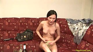 This feisty Asian chick is damn proud of her titties