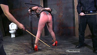Tattooed whore is punished with clothed pins