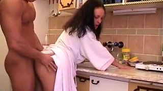 Porn pair fucking in the kitchen