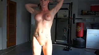 ginger girl with fit body doing some workout on webcam