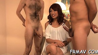 Charming japanese babe tames a thick pecker with oral