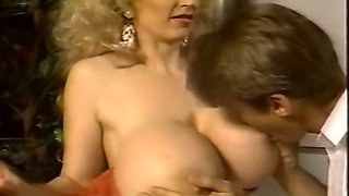 Sensational blonde classic babe with enormous boobies blows dick
