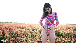 naughty lady dee pees and masturbates in a flower field
