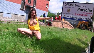 Fabulous young chick in yellow dress shows her perky breasts in public places