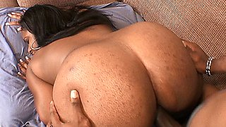 Ebony babe with a juicy butt and big titties takes a big black cock