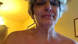 Four eyed granny with saggy breasts shows it all on webcam