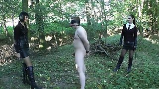 2 mistress punishing a slave in the forest