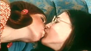Redhead and brunette cute bimbos on the couch share a dick