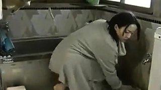 Busty oiled Amateur Asian milf fucks her ass with dildo
