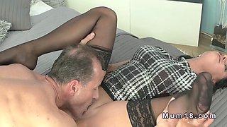 Clothed brunette Milf gets banged in bed
