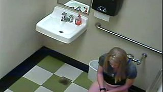 Hidden cam in the restroom catches a blonde lady peeing