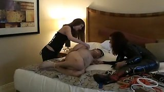 Naked man tied and dominated by two women sexy